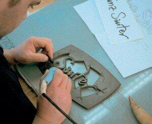 Eigen handschrift in brons